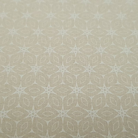 Cotton Beige Star Mosaic fabric - Organic cotton poplin-like fabric with white lines forming mosaics and stars on a beige background The fabric is 150cm wide and its composition is 100% cotton.