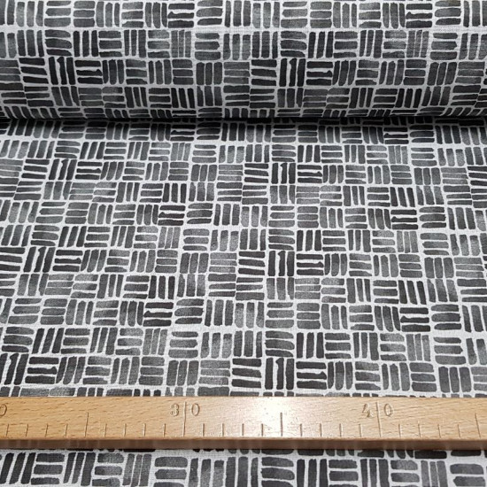 Cotton Manipur Mosaic fabric - Cotton fabric with line drawings making the mosaic shape of various colors on a white background. The fabric is 150cm wide and its composition is 100% cotton.