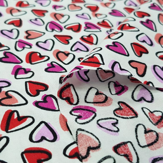 Cotton Hearts Allover White fabric - Cotton fabric with drawings of small hearts in various colors of red and pink tones on a white background. The fabric is 150cm wide and its composition is 100% cotton.