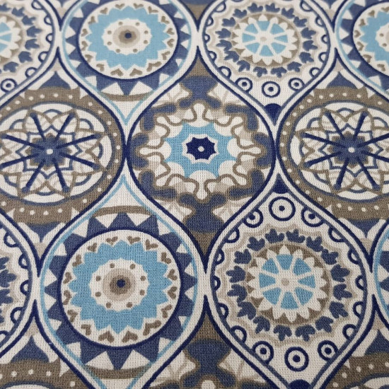 Cotton Mandalas Clock fabric - Cotton fabric with Mandalas drawings in various colors, Clock style. The fabric is 140cm wide and its composition is 100% cotton.