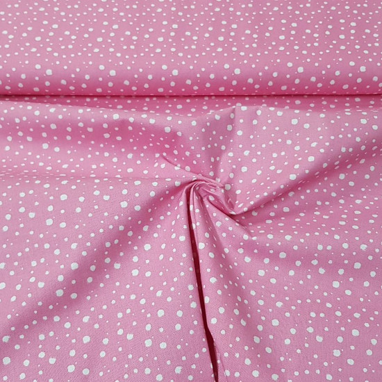 Cotton White Spots Pink fabric - Cotton fabric with patterns of white spots or splashes on a pink background. The fabric is 140cm wide and its composition is 100% cotton.