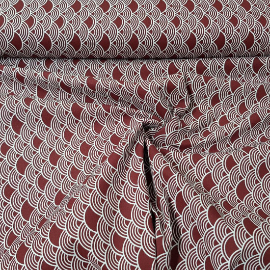 Cotton Bows Tokyo Garnet fabric - Cotton fabric with white Tokyo style bow drawings on a garnet background. The fabric is 140cm wide and its composition is 100% cotton.