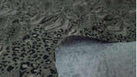 Cotton Animal Print Mix fabric - Organic cotton fabric with mixed animal print wefts in various colors. The fabric is 150cm wide and its composition is 100% cotton.