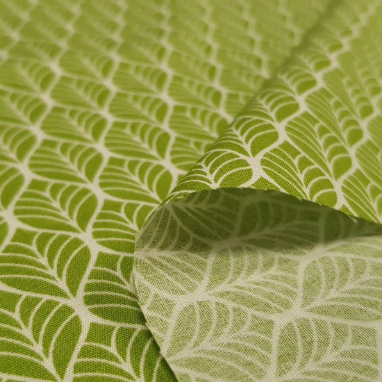 Cotton Geometric Shapes Lime fabric - Cotton fabric with geometric patterns with white lines on a lime green background. The fabric is 150cm wide and its composition is 100% cotton.