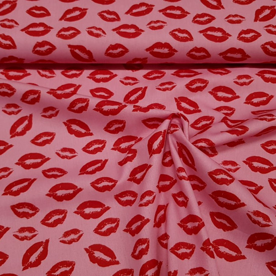 Cotton Lips Kisses fabric - Cotton fabric with drawings of lips giving kisses in various background colors. The fabric is 150cm wide and its composition is 100% cotton.