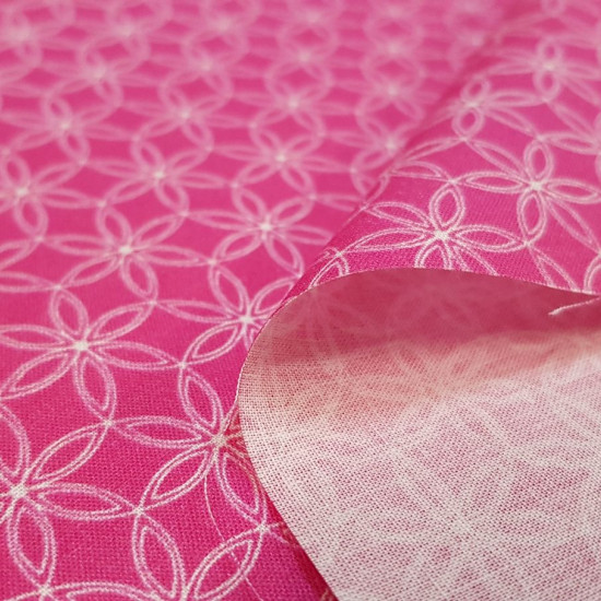 Cotton Floral Shapes Fuchsia fabric - Organic cotton fabric with white floral geometric patterns on a fuchsia background. The fabric is 150cm wide and its composition is 100% cotton.