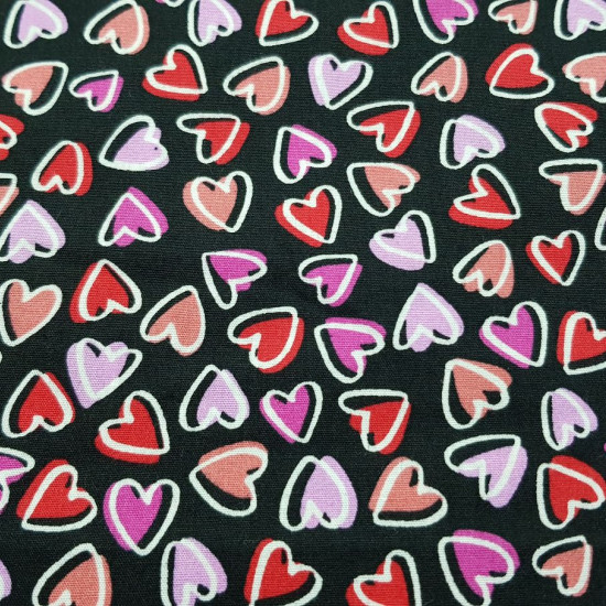 Cotton Hearts Allover Black fabric - Cotton fabric with drawings of small hearts in various colors of red and pink tones on a black background. The fabric is 150cm wide and its composition is 100% cotton.