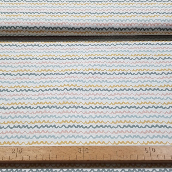 Cotton Waves Colors fabric - Poplin cotton fabric with colored waves patternon a white background. The fabric is 150cm wide and its composition is 100% cotton.