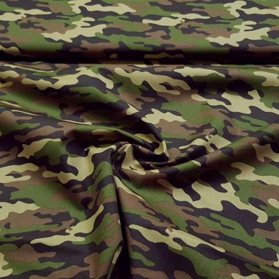 Cotton Green Camouflage fabric - Cotton fabric with camouflage print in shades of green and brown. The fabric is 140cm wide and its composition is 100% cotton.