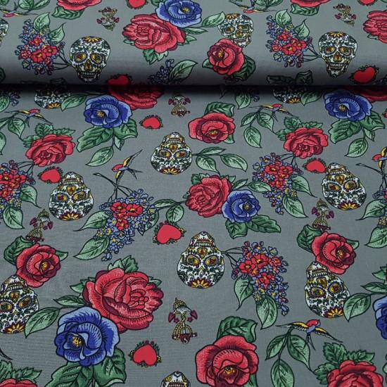 Tela Algodón Rosas y Calaveras - Tela de algodón muy original con dibujos de rosas y calaveras (calacas) en multicolor sobre un fondo gris. Este tejido es ideal para confeccionar cualquier tipo de complemento y prenda de vestir.