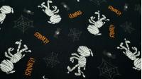 Tela Algodón Halloween Momias Arañas - Tela de algodón de temática Halloween, con dibujos de momias, arañas y telarañas sobre un fondo negro. La tela mide 140cm de ancho y su composición 100% algodón.