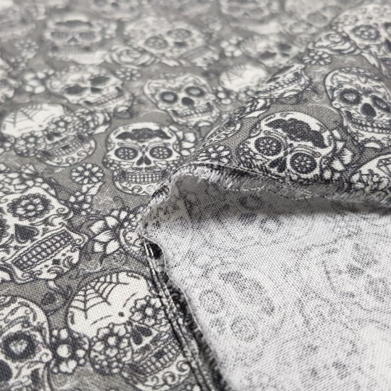 Cotton Skulls Whiteblack Tiny fabric - Cotton fabric digital printing with small drawings of Mexican skulls with black and white floral decorations on a gray background. The fabric is 140cm wide and its composition is 100% cotton