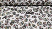 Tela Algodón Calaveras Mexicanas Calacas - Tela de algodón estampada con dibujos de calacas o calaveras de muchos colores sobre un fondo de colorblanco con flores. Típicas en la celebración del día de los muertos en México. La tela mide 140cm de ancho y