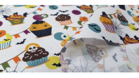 Cotton Halloween Cupcakes fabric - Cotton fabric with drawings of cupcakes decorated in Halloween style, with bones, eyes, spiders, bats... The fabric is 150cm wide and its composition is 100% cotton.