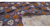 Cotton Halloween Party Hats fabric - Cotton fabric digital printing with Halloween drawings showing pumpkins, spiders with hats, skulls with hats, among other creatures, on a lilac background with candies, feathers... The fabric is 140cm wide and its co