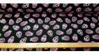 Tela Algodón Calaveras Neon Fucsia - Tela de algodón con dibujos de calaveras de color llamativo neón de color fucsia sobre un fondo de color negro. La tela mide 150cm de ancho y su composición 100% algodón.