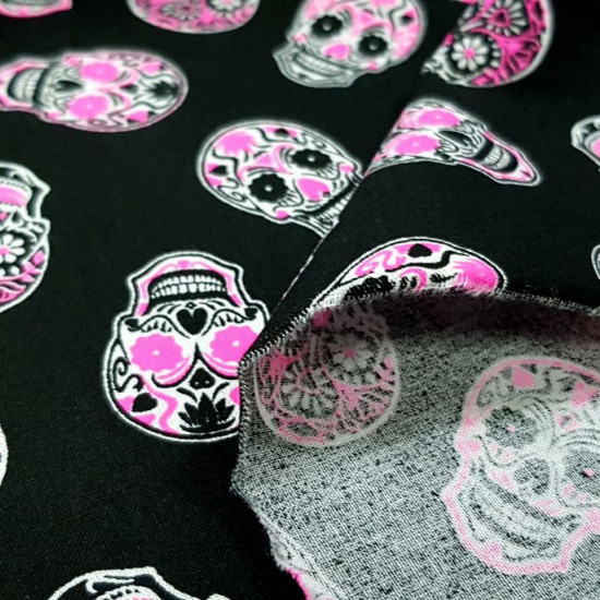 Cotton Skulls Neon Fuchsia fabric - Cotton fabric with drawings of skulls in striking neon color in fuchsia on a black background. The fabric is 150cm wide and its composition is 100% cotton.