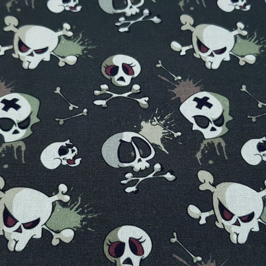 Cotton Skulls Comic fabric - Organic cotton fabric with comic style pirate skull drawings, on various backgrounds to choose from. The fabric is 150cm wide and its composition is 100% cotton.
