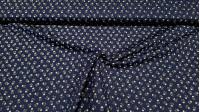 Tela Algodón Calaveritas - Tela de algodón con dibujos de calaveras pequeñas sobre varios fondos a elegir. La tela mide 150cm de ancho y su composición 100% algodón.