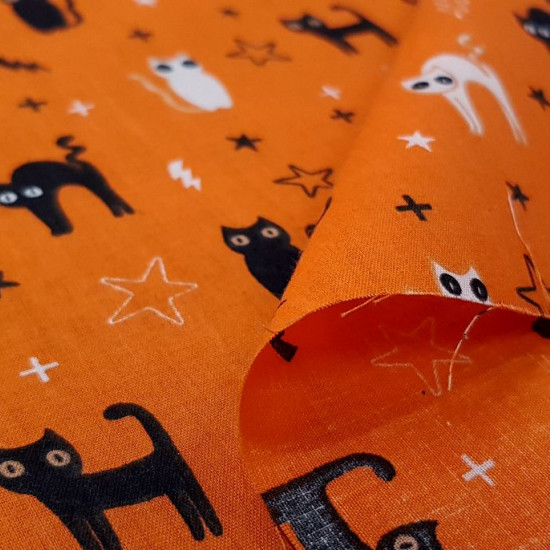 Polycotton Halloween Cats Orange fabric - Fine polyester and cotton fabric with Halloween-themed drawings with black and white cats on an orange background with rays and stars. The fabric is 110cm wide and its composition is 80% polyester - 20% cotton.