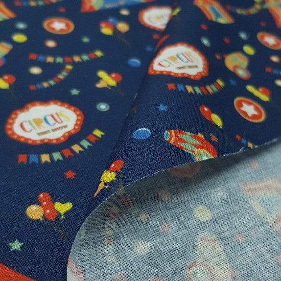 Cotton Circus Tents Blue fabric - Circus themed cotton fabric with drawings of tents, colored balloons, cannons, pennants ... on a dark blue background.