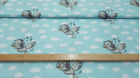 Cotton Birds Listening to Music fabric - Funny cotton fabric with children's themes with drawings of birds listening to music in helmets, on a blue background with clouds.