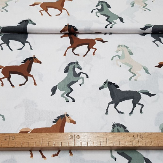 Cotton Horses Running fabric - Cotton fabric with drawings of horses in brown and gray colors, running on a white background. The fabric is 150cm wide and its composition 100% cotton