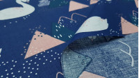 Cotton Swans between mountains blue fabric - Children's cotton poplin fabric with drawings of white swans on a dark blue background on which mountain shapes appear. The fabric is 160cm wide and its composition 100% cotton.