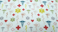 Cotton Medicine Pharmacy Symbols fabric - Organic cotton poplin fabric with medical themed drawings, in which several colored symbols related to the pharmacy appear, such as the Bowl of Hygieia or the crosses. The drawings are on a white background. The f