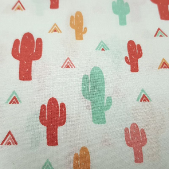 Cotton Cactus Colors Teepee fabric - Children's cotton poplin fabric with cactusdrawings in mint green, tile red, pink and mustard on a white background with combined colored teepee tents. The fabric is 150cm wide and its composition 100% cotton.