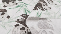 Cotton Green Bamboo Pandas fabric - Children's cotton poplin fabric with drawings of panda bears on a background of green bamboo canes. Fabric made in Spain. The fabric is 150cm wide and its composition is 100% cotton.