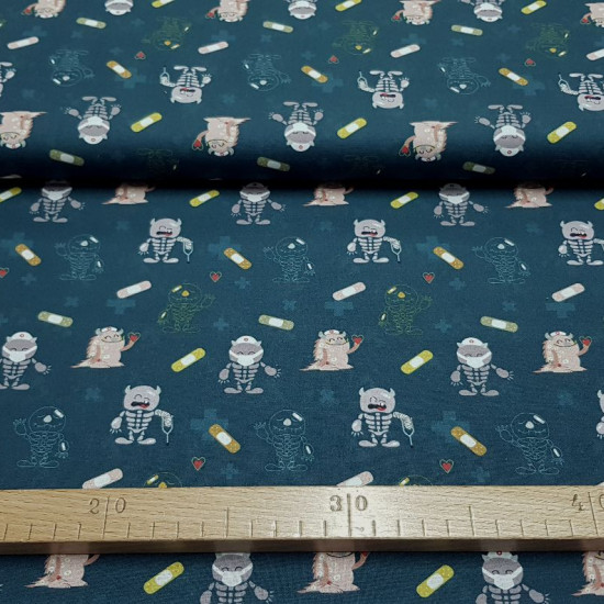 Cotton Medicine Monsters Band-Aids Blue fabric - Organic cotton poplin fabric with medicine-themed drawings and funny monster drawings with casts, masks, hearts on a dark blue background. The fabric is 150cm wide and its composition is 100% cotton.