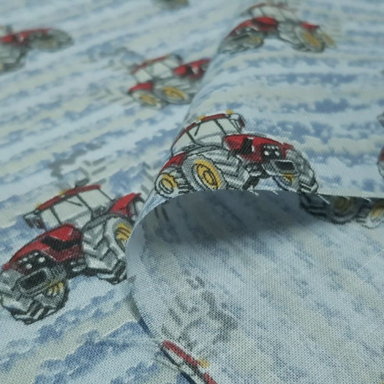 Cotton Red Tractors fabric - Cotton fabric with drawings of red tractors on a background of wheel tracks and strokes in gray and blue colors. The fabric is 150cm wide and its composition is 100% cotton.