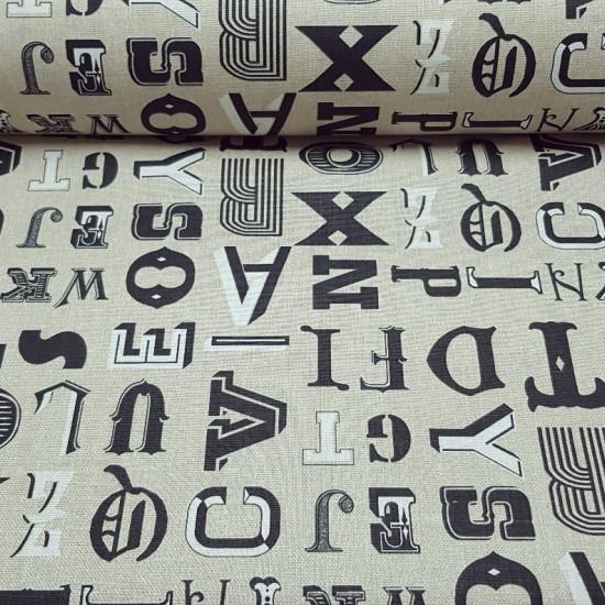 Tela Algodón Letras Grandes Fondo Beige - Tela de algodón con dibujos de letras grandes tipo corpóreas de color negro sobre un fondo beige/tostado La tela mide 160cm de ancho y su composición 100% algodón.