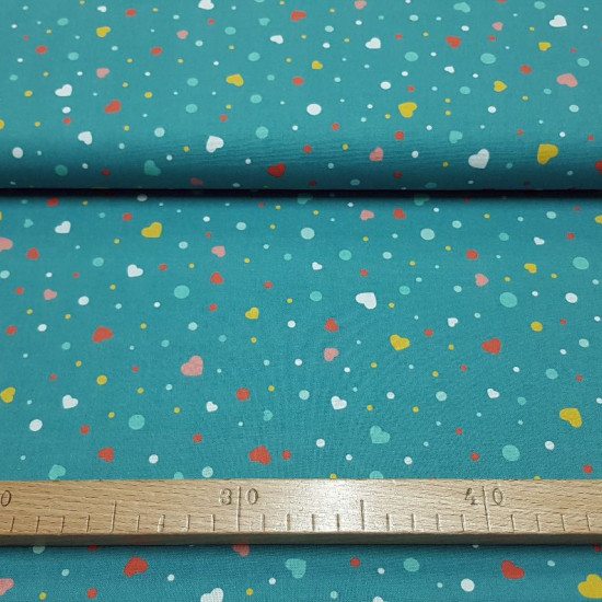 Cotton Hearts and Polka Dots Petrol Blue fabric - Cotton poplin fabric with colorful hearts and polka dots on a petrol blue background. The fabric is 150cm wide and its composition is 100% cotton.