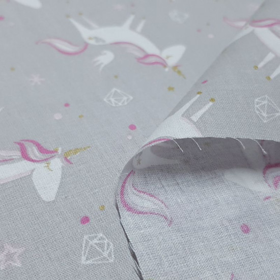Cotton Unicorns Gray Background fabric - Cotton poplin fabric with unicorn drawings with fuchsia mane and golden horn on a gray background with white diamonds and stars. The fabric is 150cm wide and its composition is 100% cotton.