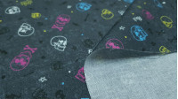 Cotton Rock Skulls fabric - Cotton fabric with drawings of various colored skulls on a dark gray background with Rock letters, multi-colored rays and bones. The fabric is 150cm wide and its composition is 100% cotton.