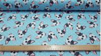 Tela Algodón Caritas Bulldog Azul - Tela de algodón impresión digital satinada con dibujos de caras de perritosBulldogsobre un fondo azul con topos claros. La tela mide 140cm de ancho y su composición 100% algodón.