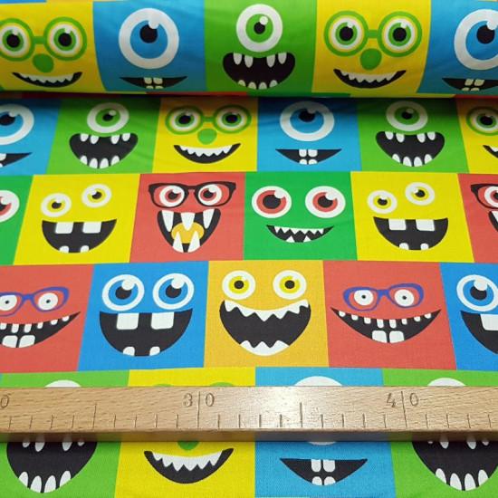 Tela Algodón Caras Monstruos Colores - Tela de algodón impresión digital satinada muy divertida con dibujos de caras de monstruos coloridas en recuadros. La tela mide 140cm de ancho y su composición 100% algodón.