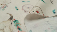Cotton Dreamcatcher Feathers fabric - Poplin cotton fabric with drawings of dream catchers, feathers and skulls of animals on a light beige background. The fabric is 140cm wide and its composition is 100% cotton.