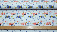 Cotton Elephants Flowers fabric - Children's cotton fabric with drawings of elephants with flowers on parts of their bodies, vegetation of palm trees on a light blue background. You can also see the elephant calves next to each large elephant. The fa