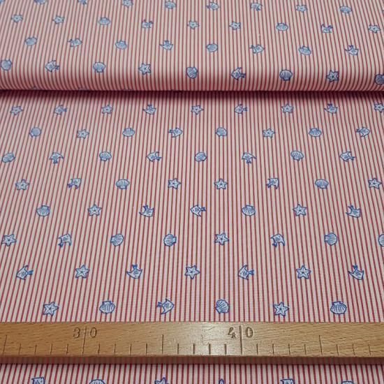 Tela Algodón Rayas Playa Rojo - Tela de algodón con rayas finitas de color rojo con dibujos de conchas de playa, peces y estrellas de mar. La tela mide 150cm de ancho y su composición 100% algodón.