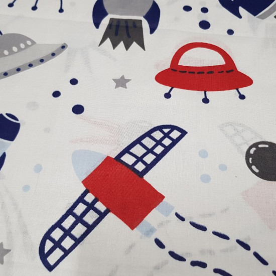 Cotton Space Rockets fabric - Cotton fabric with drawings of space rockets, satellites, ships and stars on a white background. The fabric is 160cm wide and its composition is 100% cotton.