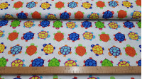 Cotton Turtles Colors fabric - Cotton fabric with children's drawings of colorful turtles on a white background. The fabric is 150cm wide and its composition is 100% cotton.