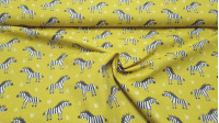 Cotton Zebra Lime Yellow fabric - Children's cotton fabric with zebra patterns on a striking lime yellow background. The fabric is 150cm wide and its composition is 100% cotton.