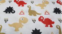 Tela Algodón Dinosaurios Triángulos - Tela de algodón muy divertida de dinosaurios de varios colores y formas de triángulos sobre un fondo blanco. La tela mide 160cm de ancho y su composición 100% algodón.