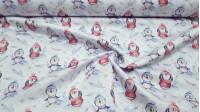 Tela Algodón Pingüinos Abrigados - Tela de algodón satinada estampación digital con dibujos de pingüinos abrigados con su gorrito y bufanda sobre un fondo claro con copos de nieve y ramas nevadas. La tela mide 140cm de ancho y su composición 100% algo