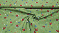 Cotton Hearts Sport Green fabric - Organic cotton poplin fabric with drawings of hearts doing sports, other smaller hearts of different colors and strips on a green background. The fabric is 150cm wide and its composition is 100% cotton.
