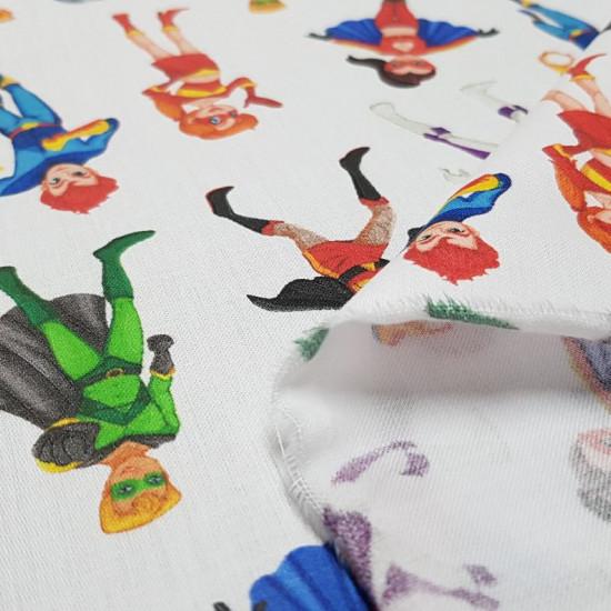 Tela Algodón Superhéroes - Tela de algodón satinado con dibujos de superhéroes y superheroinas sobre un fondo blanco. La tela mide 140cm de ancho y su composición 100% algodón.
