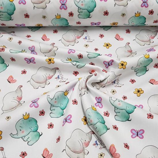 Tela Algodón Elefantes Mariposas - Preciosa tela de algodón satinado con dibujos infantiles de elefantes con coronas y decorado con flores y mariposas sobre un fondo blanco. La tela mide 140cm de ancho y su composición 100% algodón.